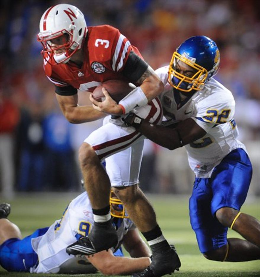Nebraska quarterback Taylor Martinez carries the ball against South Dakota State in the first half of their NCAA college football game, in Lincoln, Neb., Saturday, Sept. 25, 2010. (AP Photo/Nati Harnik)