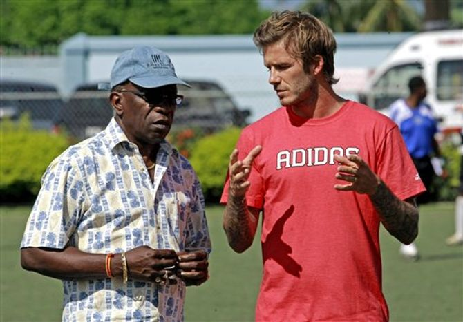 David Beckham, former England's soccer team captain and Los Angeles Galaxy midfielder speaks with reporters during a coaching clinic with young players in Macoya, Trinidad and Tobago, Sunday, Sept. 26, 2010. Beckham is visiting Trinidad and Tobago to bolster both England's World Cup bid and Caribbean youth football. (AP Photo/Anthony Harris)