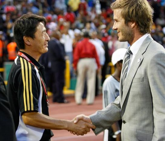 David Beckham, right, shakes hands with Japan's head coach Hiroshi Yoshida prior to the final match of the Women's U-17 Soccer World Cup between South Korea and Japan at Hasely Crawford Stadium in Port-of-Spain, Trinidad, Saturday Sept. 25, 2010. Beckham is in Trinidad to for a workshop sponsored by his soccer academy. (AP Photo/Anthony Harris)