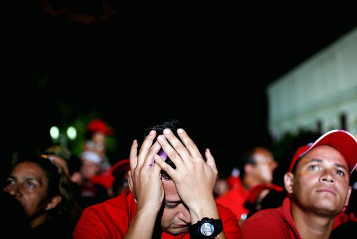 Supporters of Venezuelan President Hugo Chavez react Monday in Caracas to results of congressional elections Sunday. Mr. Chavez lost a significant number of allies in the National Assembly. (Associated Press)