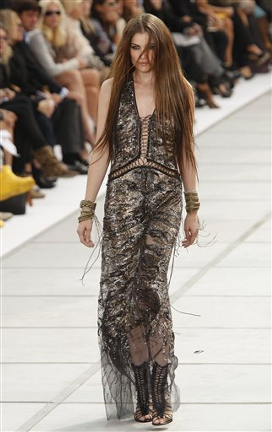 French supermodel and actress Laetitia Casta shows a creation part of the Roberto Cavalli Spring-Summer 2011 fashion collection, during the fashion week in Milan, Italy, Monday, Sept. 27, 2010. (AP Photo/Antonio Calanni)