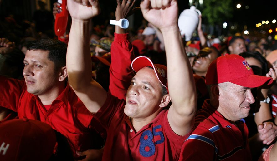 Supporters of Venezuelan President Hugo Chavez react as they listen the results of congressional elections outside the Presidential Palace in Caracas, Venezuela, early on Monday, Sept 27, 2010. (AP Photo/Ariana Cubillos)