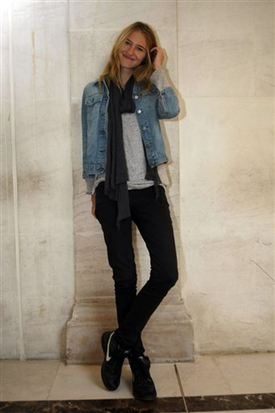 """American model Sara Ziff poses in Paris, Monday, Sept. 27, 2010. Ziff who began her decade-long career at age 14, started making home videos backstage as a lark along with Ole Schell, a NYU film school student. Ziff says she hopes """"Picture Me,"""" which opens in France next month, will be a """"catalyst for change"""" in the industry. (AP Photo/Jacques Brinon)"""
