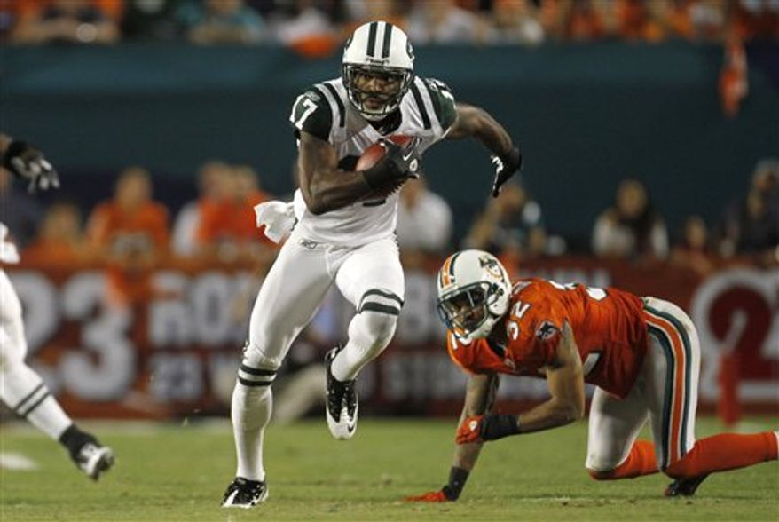 Miami Dolphins wide receiver Davone Bess catches a pass as New York Jets cornerback Kyle Wilson defends during the second quarter of an NFL football game, Sunday, Sept. 26, 2010 in Miami. (AP Photo/J Pat Carter)