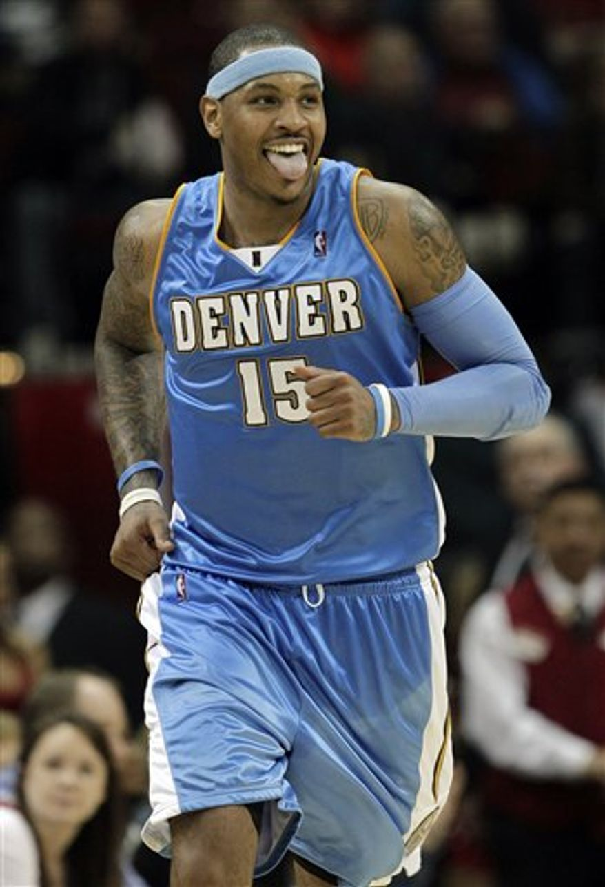 FILE - In this March 15, 2010, file photo, Denver Nuggets' Carmelo Anthony (15) reacts after scoring a basket against the Houston Rockets during the fourth quarter of a NBA basketball game in Houston. After failing to lure either LeBron James, Dwyane Wade or Chris Bosh to New Jersey during the much-publicized free agency sweepstakes this summer, the Nets are engaged in trade talks to acquire Carmelo Anthony. A person close to the talks who requested anonymity because he was not authorized to speak for the team told The Associated Press on Friday that the team was involved in very complicated talks with the Denver Nuggets for the small forward.  Yahoo! Sports first reported the trade talks. (AP Photo/David J. Phillip, File)
