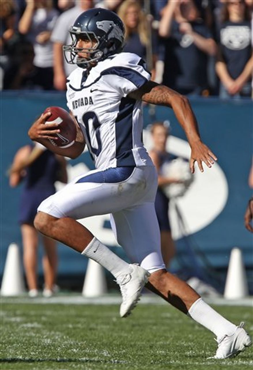 Nevada's Via Taua celebrates a touchdown with his teammates in a game against BYU during the first half of an NCAA college football game at LaVell Edwards Stadium in Provo, Utah, Saturday, Sept. 25, 2010. Nevada beat BYU 27-13. (AP Photo/George Frey)
