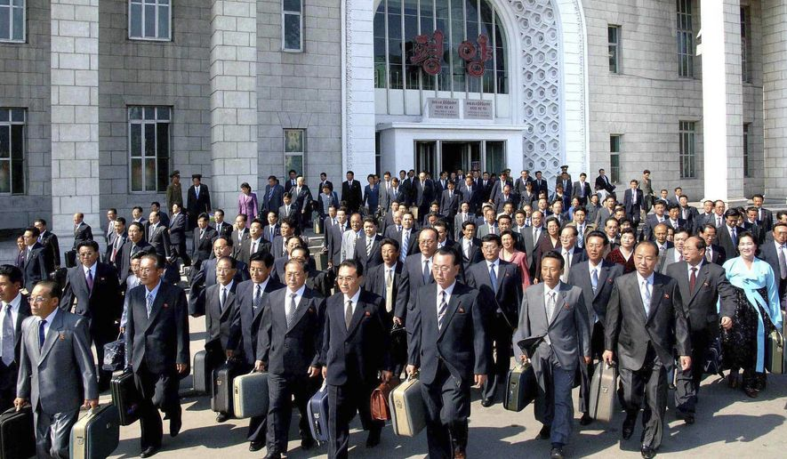 In this photo released by Korean Central News Agency via Korea News Service, delegates to the ruling Worker's Party meeting make their way upon arriving at Pyongyang station, North Korea, on Monday Sept. 27, 2010. (AP Photo/Korean Central News Agency via Korea News Service)