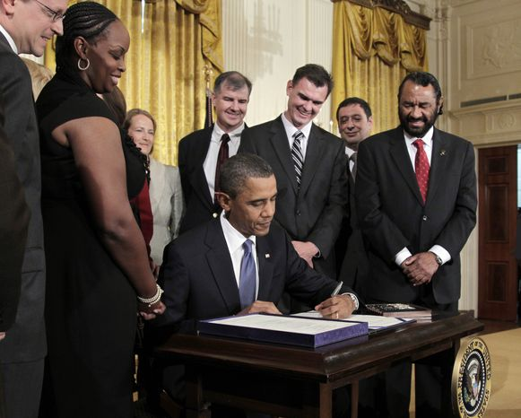 President Obama signs the Small Business Jobs Act, Monday, Sept. 27, 2010, in the East Room of the White House in Washington. (AP Photo/J. Scott Applewhite)