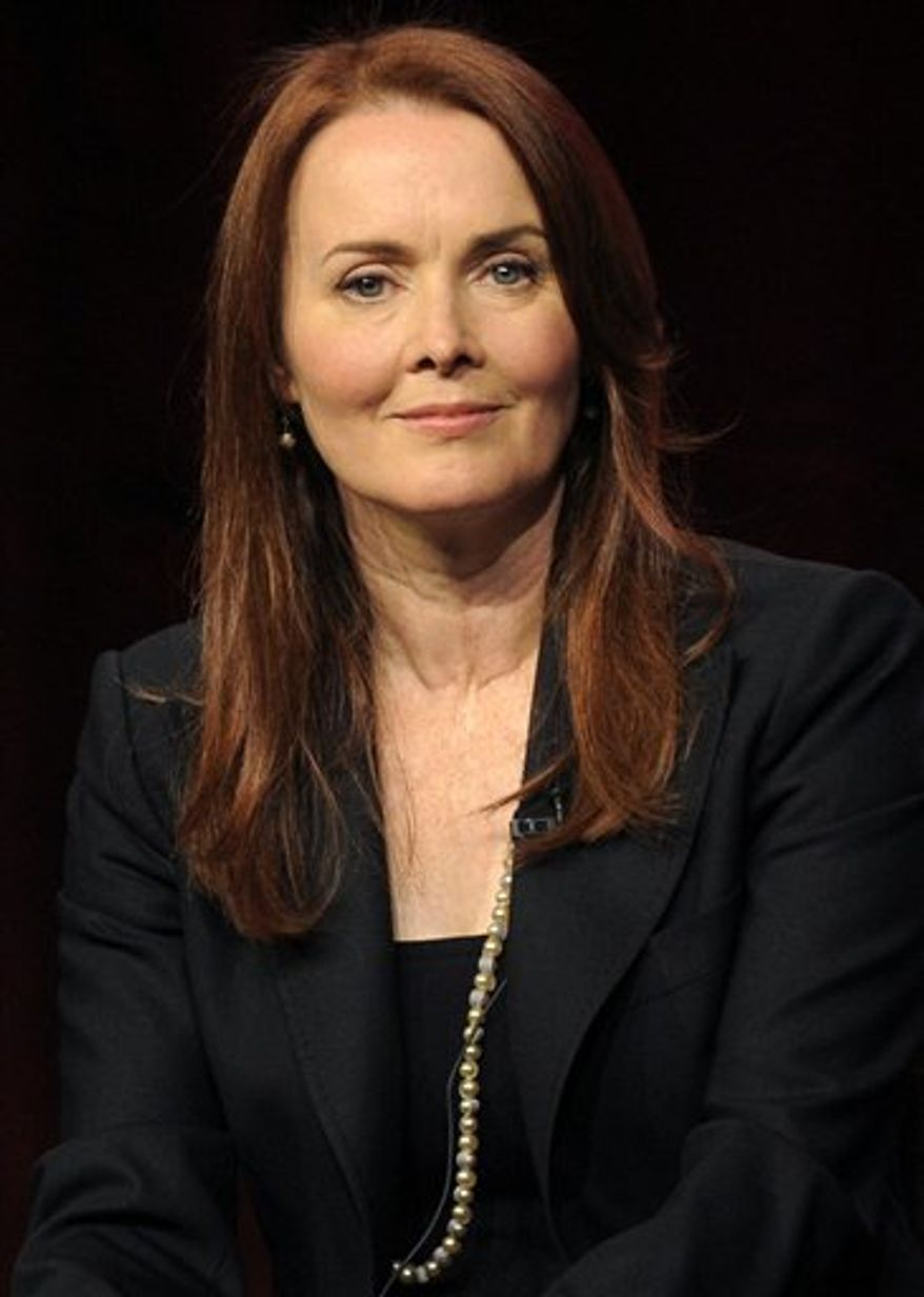 "FILE - In this July 30, 2010 file photo, Laura Innes, a cast member in ""The Event,"" takes part in a panel discussion during the NBC Universal Television Critics Association summer press tour in Beverly Hills, Calif. (AP Photo/Chris Pizzello, file)"