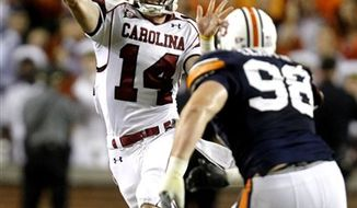 Auburn defensive back Demond Washington (14) intercepts a pass intended for South Carolina wide receiver Alshon Jeffery (1) to clinch a 35-27 Auburn victory during an NCAA college football game Saturday, Sept. 25, 2010, in Auburn, Ala. (AP Photo/Butch Dill)