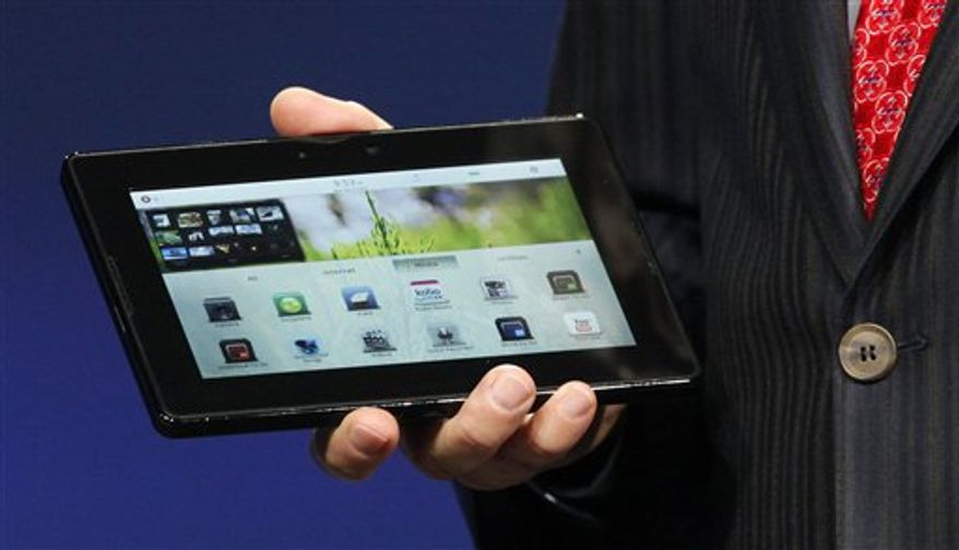 Mike Lazaridis, president and co-CEO of Research in Motion Ltd. (RIM), holds the new PlayBook during the BlackBerry developers conference 2010 in San Francisco, Monday, Sept. 27, 2010. RIM showed off the tablet for the first time and is set to launch it early 2011, with an international rollout later in the year. With it RIM is betting on a smaller, lighter device than Apple Inc.'s iPad, which kicked-started the tablet market when it launched in April. (AP Photo/Jeff Chiu)