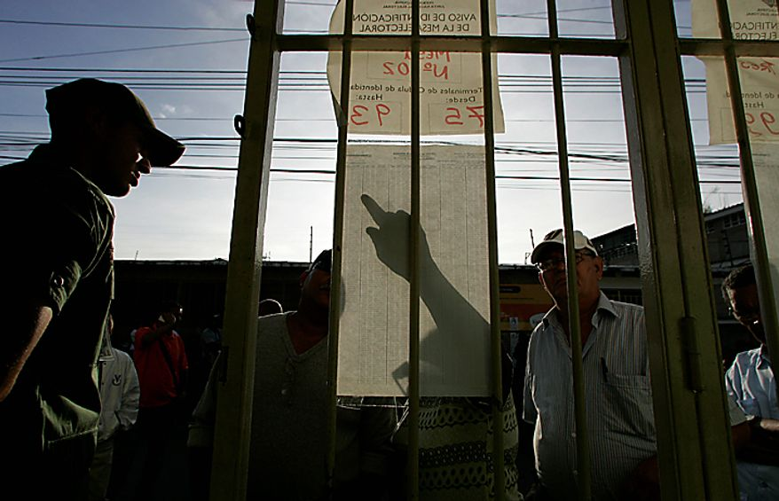 People look for their polling station during congressional elections in Caracas, Venezuela, Sunday, Sept. 26, 2010. (AP Photo/Leonardo Ramirez)