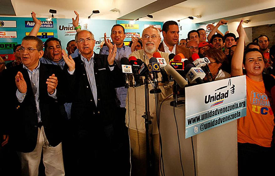 Opposition members celebrate after National Electoral Council announced results of congressional elections in Caracas, Venezuela, Monday , Sept 27, 2010. President Hugo Chavez held on to a congressional majority in elections Sunday, but his opponents made gains that could help them challenge his grip on power. (AP Photo/Leonardo Ramirez)