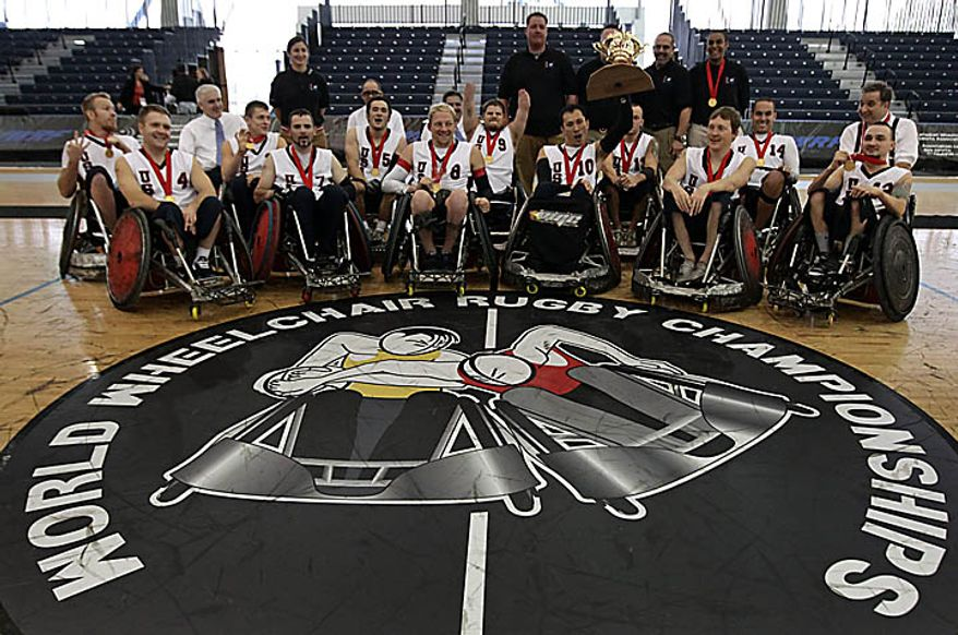 Team USA celebrates their gold medal victory over Australia at the World Wheelchair Rugby Championships in Richmond, British Columbia, Canada, on Sunday Sept.  26, 2010. (AP Photo/The Canadian Press, Darryl Dyck)