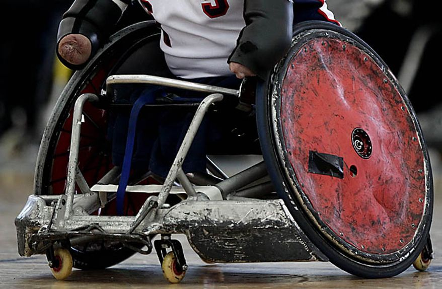 USA's Nick Springer maneuver his wheelchair while playing Australia during the gold medal match at the World Wheelchair Rugby Championships in Richmond, British Columbia, Canada on Sunday Sept. 26, 2010. (AP Photo/The Canadian Press, Darryl Dyck)