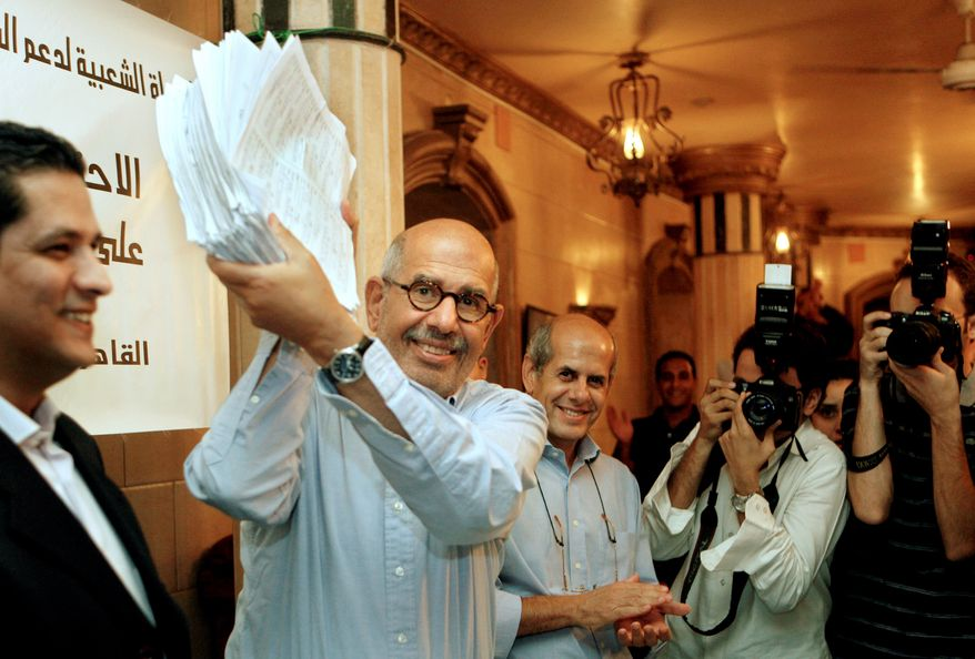 In Cairo, Nobel peace laureate and former nuclear-watchdog agency head Mohamed ElBaradei holds up signed petitions gathered online to support his call for democratic reforms in Egypt. A nascent youth opposition movement looks to him for leadership but, recognizing political realities, is focusing on organization. (Associated Press)