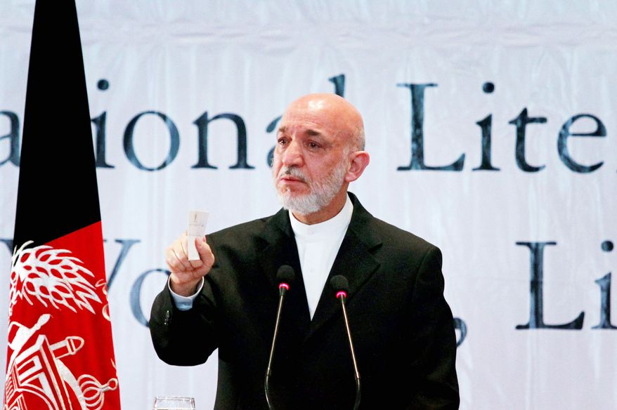 """Afghan President Hamid Karzai decried the violence in his country and expressed fear that the mayhem would chase away young Afghans. He has established a """"peace council"""" to negotiate with the Taliban. (Associated Press)"""