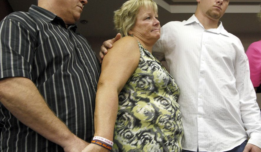 Tony Wilhite (left) and his wife, Betsy, stand with son Jon Wilhite, 24, at news conference after a jury convicted a drunken driver of murder in the deaths of a promising baseball rookie, Los Angeles Angels pitcher Nick Adenhart, and two of his friends. Jon Wilhite was in the same car and was severely injured when the impact separated his spine from his skull. (AP Photo/Nick Ut)