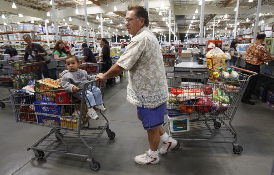 In this Sept. 8, 2010, photo, a Costco customer leaves the check out stand with two carts at Costco in Mountain View, Calif. Americans' view of the economy turned grimmer in September amid escalating job worries, falling to the lowest point since February. (AP Photo/Paul Sakuma)