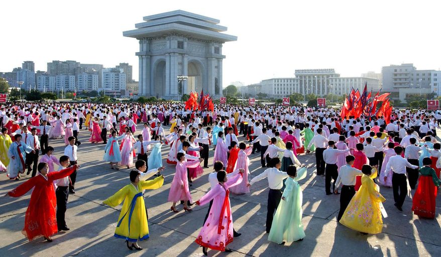 In this photo released by Korean Central News Agency via Korea News Service, North Korean youth dance to celebrate North Korean leader Kim Jong-il's re-election to the party's top position of general secretary in a Workers' Party meeting in Pyongyang, North Korea, Tuesday, Sept. 28, 2010. (AP Photo/Korean Central News Agency via Korea News Service)