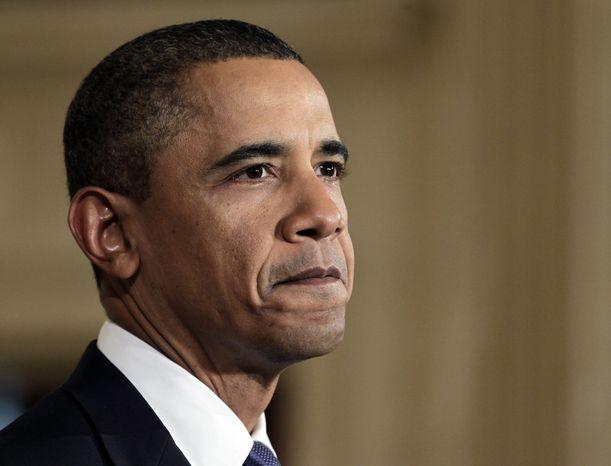 ** FILE ** President Obama (AP Photo/J. Scott Applewhite)