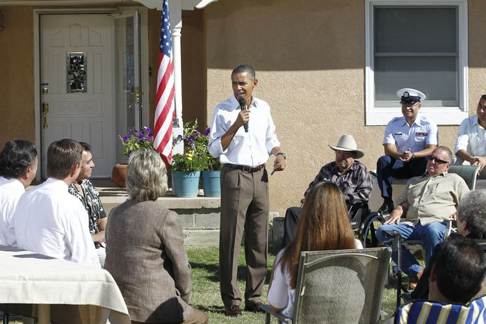 President Obama holds a discussion on the economy with neighborhood families in the front yard of a home in Albuquerque, N.M., Tuesday, Sept. 28, 2010. (AP Photo/Charles Dharapak)