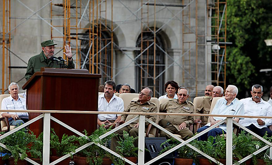 Cuba's leader Fidel Castro, top left, delivers a speech during the 50th anniversary of the Committee for the Defense of the Revolution, CDR, in Havana, Cuba, Tuesday, Sept. 28, 2010. (AP Photo/Javier Galeano)