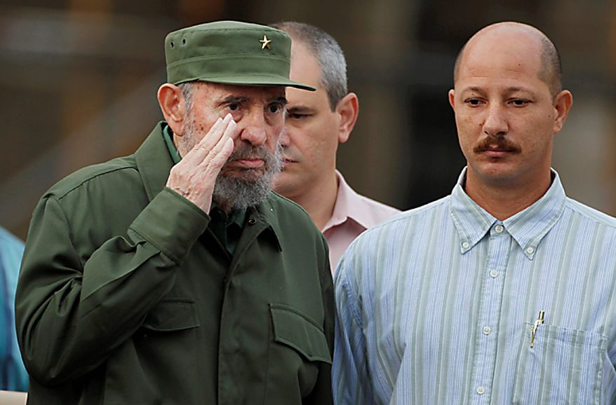 Cuba's leader Fidel Castro listens to his national anthem before delivering a speech during the 50th anniversary of the Committee for the Defense of the Revolution, CDR, in Havana, Cuba, Tuesday, Sept. 28, 2010.(AP Photo/Javier Galeano)