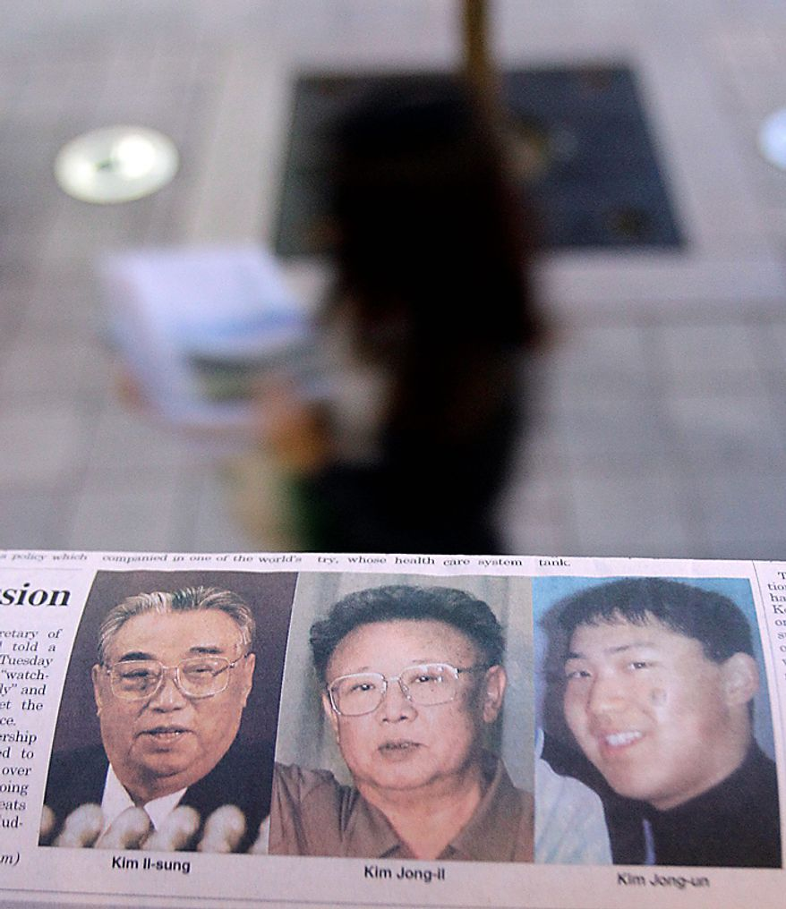 A South Korean newspaper bearing photos of North Korean leader Kim Jong Il, center, and his late father Kim Il Sung, left, and a photo South Korean media says of Kim's youngest son Kim Jong Un, is displayed at a news stand in Seoul,  South Korea, Tuesday, Sept. 28, 2010. North Korea's Kim Jong Il made his elusive youngest son a four-star general in a major promotion seen Tuesday as confirmation that he is slated to become the country's next leader. (AP Photo/ Lee Jin-man)