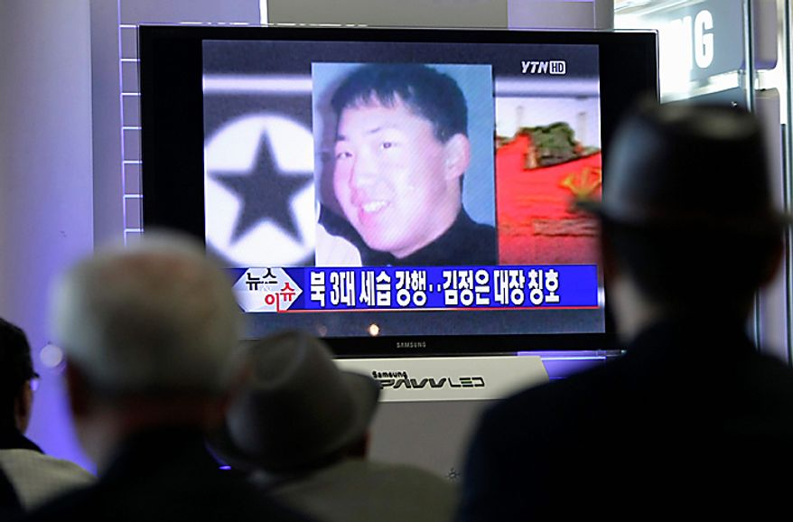 "South Koreans watch a TV news program at the Seoul Railway Station in Seoul, South Korea, Tuesday, Sept. 28, 2010. North Korea's absolute leader Kim appointed his youngest son as an army general, giving the son his first known official title in an apparent sign that he is being groomed as the country's next leader. South Korean media said Kim's youngest son Kim Jong Un is shown in a portrait on the screen. The headline read ""Kim Jong Un to the rank of general."" (AP Photo/Ahn Young-joon)"