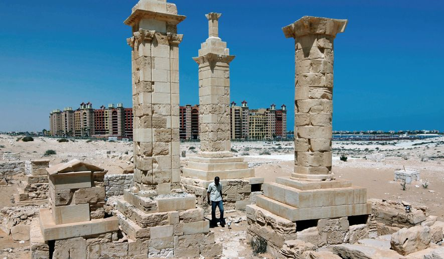 A five-star hotel in the Egyptian resort city of Marina is the backdrop for restored Roman pillar tombs from the Greco-Roman port city of Leukaspis on the Mediterranean coast. (Associated Press)