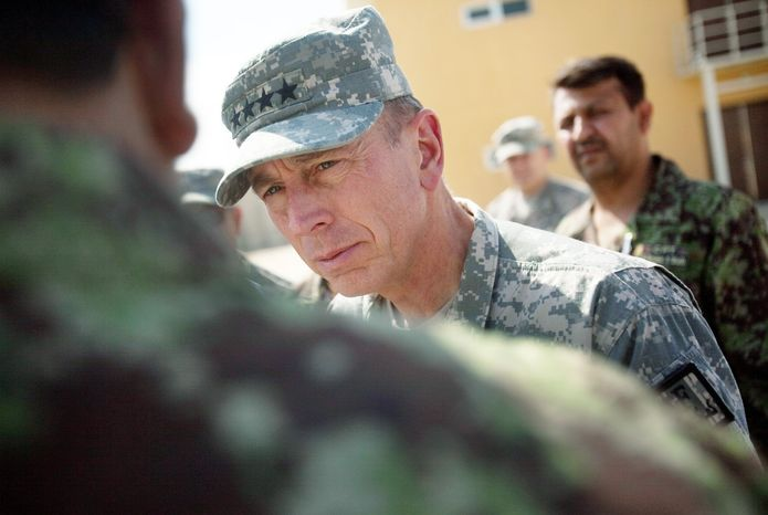 ** FILE ** Gen. David H. Petraeus, the top U.S. and NATO commander in Afghanistan, speaks in September 2010 with Afghan military personnel during a tour of the U.S. run-Parwan detention facility north of Kabul, Afghanistan. (AP Photo)