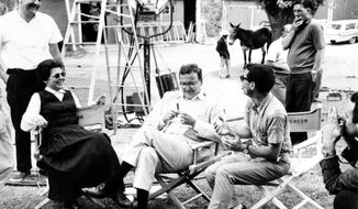 "Arthur Penn (right), is shown in this photo from July 28, 1961, taking a break in the filming of ""The Miracle Worker"" with actress Anne Bancroft and producer Fred Coe. (Associated Press)"