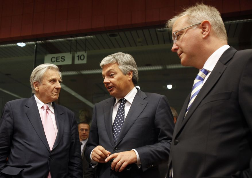 Belgian Finance Minister Didier Reynders, center, speaks with European Central Bank President Jean Claude Trichet, left, and European Commission for Economy Olli Rehn during a financial task force meeting at the EU Council building in Brussels on Monday, Sept. 6, 2010. (AP Photo/Virginia Mayo)