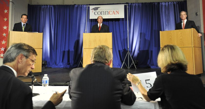 Democratic candidate for governor Dan Malloy, top left, Independent candidate Tom Marsh, top center, and Republican candidate Tom Foley, top right, debate in Middletown, Conn., on Tuesday, Sept. 28, 2010. (AP Photo/Jessica Hill)
