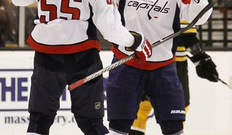 ASSOCIATED PRESS Washington Capitals' Nicklas Backstrom is congratulated by defenseman Jeff Schultz (55) after scoring against the Boston Bruins during the second period of a preseason NHL hockey game in Boston on Wednesday, Sept. 29, 2010.