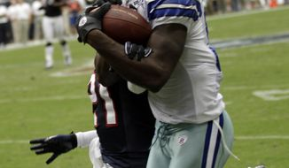 ASSOCIATED PRESS Dallas Cowboys wide receiver Dez Bryant (88) catches a pass for a first down as Houston Texans cornerback Brice McCain (21) defends in the fourth quarter of an NFL football game Sunday, Sept. 26, 2010, in Houston. The Cowboys beat the Texans 27-13.
