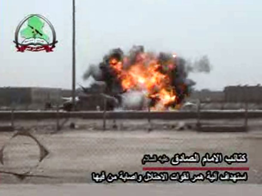 An undated image made from a video posted on an insurgent website shows a Humvee struck by an explosion that the Shi'ite militia Asaib Ahl al-Haq claims was an attack on U.S. troops on Wednesday, Sept. 15, 2010, in Basra, Iraq. (AP Photo)