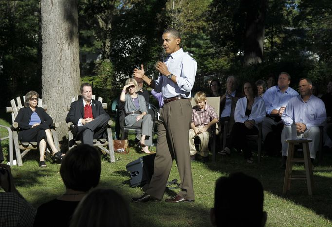 President Obama speaks during a discussion with neighborhood families in the backyard of the Clubb family in Des Moines, Iowa, Wednesday, Sept. 29, 2010. (AP Photo/Charles Dharapak)