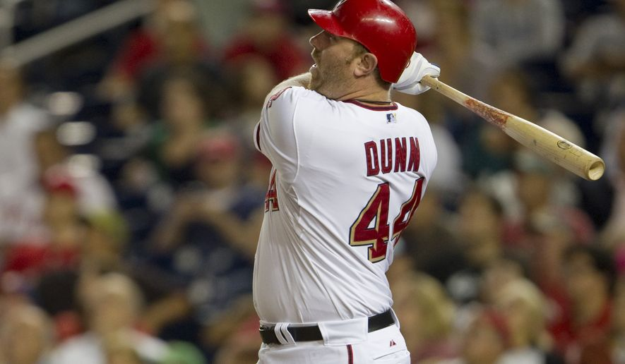 ASSOCIATED PRESS Washington Nationals' Adam Dunn watches his game-winning home run during the ninth inning of a baseball game against the Philadelphia Phillies on Tuesday, Sept. 28, 2010, in Washington. The Nationals won 2-1.