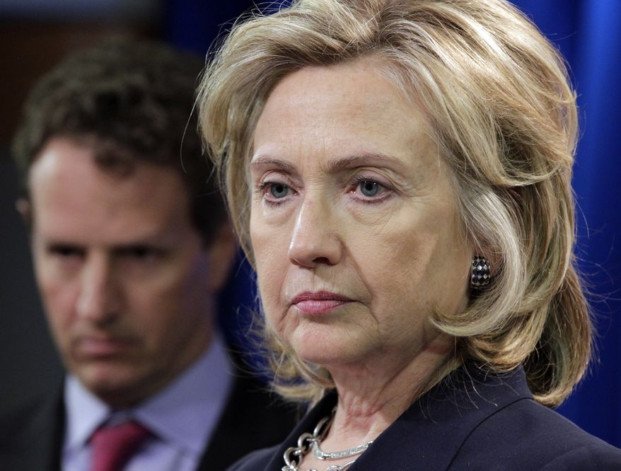 Secretary of State Hillary Rodham Clinton, accompanied by Treasury Secretary Timothy Geithner, talks about human rights abuses in Iran, Wednesday, Sept. 29, 2010, at the State Department in Washington. (AP Photo/J. Scott Applewhite)