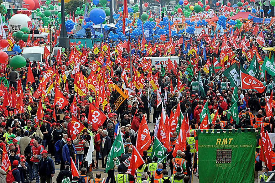 Demonstrators march down a main boulevard in Brussels, Belgium on Wednesday, Sept. 29, 2010. Labor unions organized a march of nearly 100,000 workers of the European Union institutions to protest the budget slashing plans and austerity measures of governments seeking to control spiraling debt. (AP Photo/Geert Vanden Wijngaert)