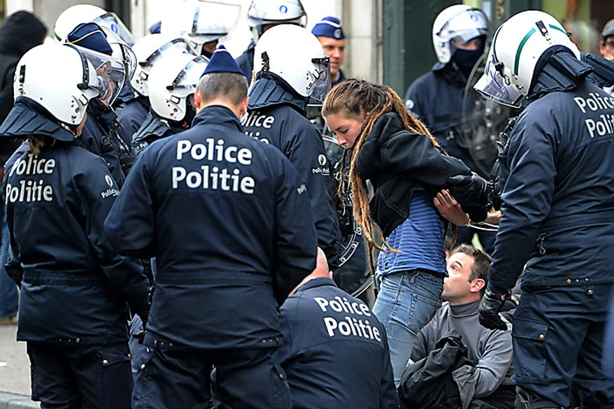 Riot police detain protesters in Brussels, Belgium on Wednesday, Sept. 29, 2010. Labor unions organized a march of nearly 100,000 workers of the European Union institutions on Wednesday  to protest the budget slashing plans and austerity measures of governments seeking to control spiraling debt. (AP Photo/Geert Vanden Wijngaert)