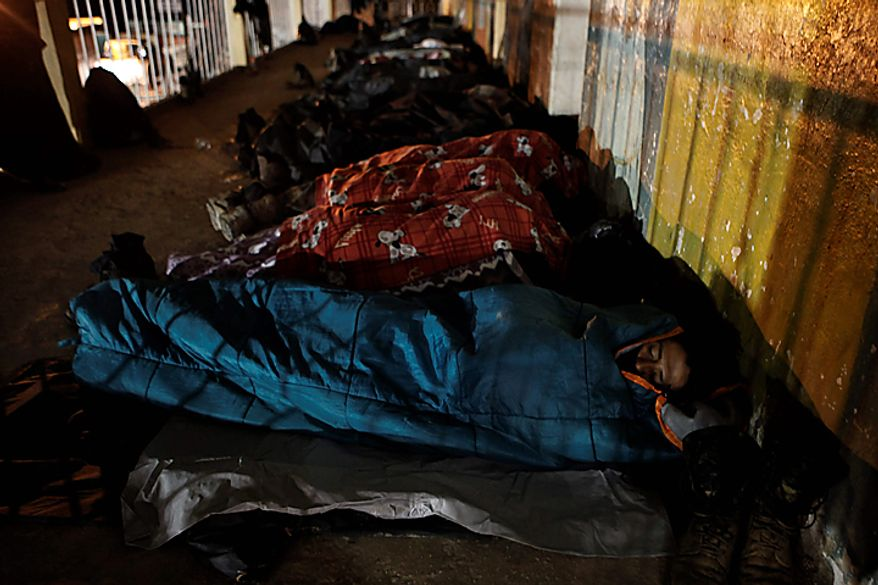 People rest at a temporary shelters in Santa Maria de Tlahuitoltepec, Oaxaca state, Mexico, Wednesday, Sept. 29, 2010. The mudslide has left 11 people missing and there are no confirmed dead, authorities said Tuesday night, backing off earlier predictions of a catastrophe in Mexico's rain-soaked southern state of Oaxaca. (AP Photo/Miguel Tovar)