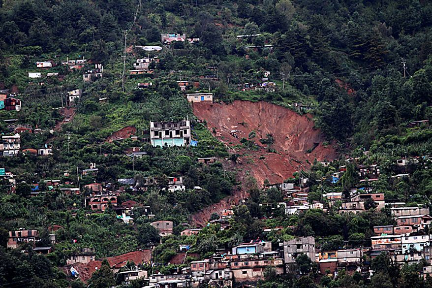 Overall view of the town of Santa Maria de Tlahuitoltepec, Mexico, Tuesday Sept. 28, 2010, after a landslide occurred. A mudslide first thought to have buried hundreds of people has left 11 missing and there are no confirmed dead, authorities said, backing off earlier predictions of a catastrophe in Mexico's rain-soaked southern state of Oaxaca. (AP Photo/Luis Alberto Cruz Hernandez)
