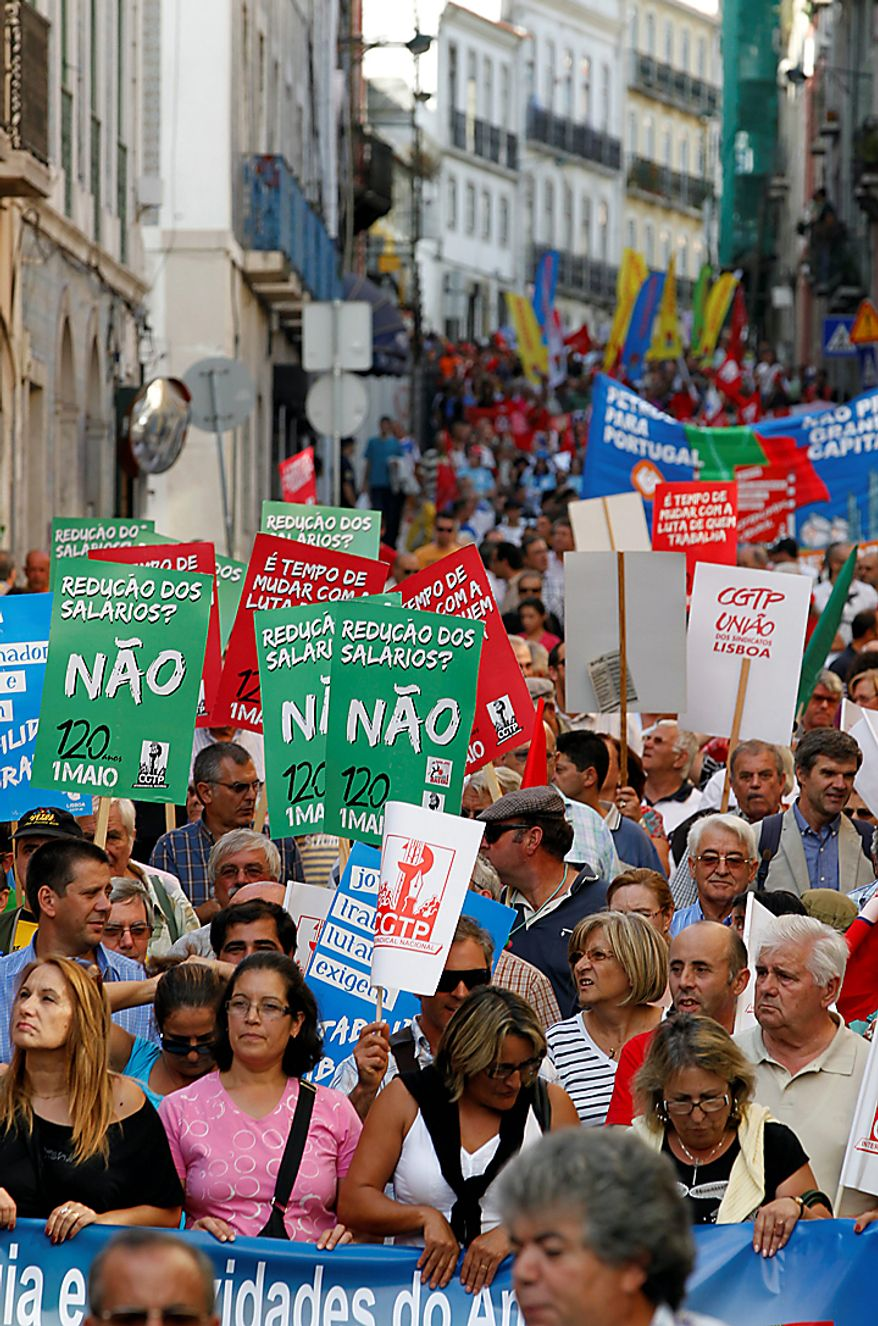 Thousands of demonstrators march in Lisbon Wednesday, Sept. 29 2010,  demanding more and better employment.  Portugal's government convened an unscheduled Cabinet meeting Wednesday as it came under fierce pressure to explain how it intends to steer the country out of a deepening financial crisis. (AP Photo/Armando Franca)