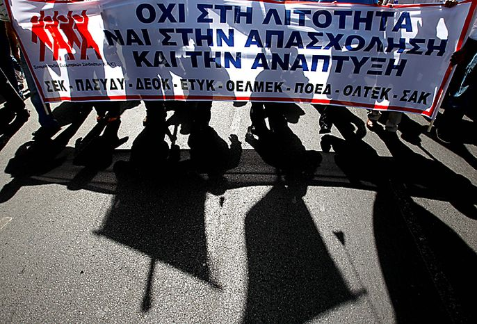 """Demonstrators march as hold a bunner tha read in Greek, """"No to the frugality yes to the employment and to the development"""" outside of Finance Ministry during an  anti-austerity protests in capital Nicosia, Cyprus, Wednesday, Sept. 29, 2010. Anti-austerity demonstrations erupted across Europe to protest the budget-slashing, tax-hiking, pension-cutting austerity plans of European governments seeking to control their debt. (AP Photo/Petros Karadjias)"""