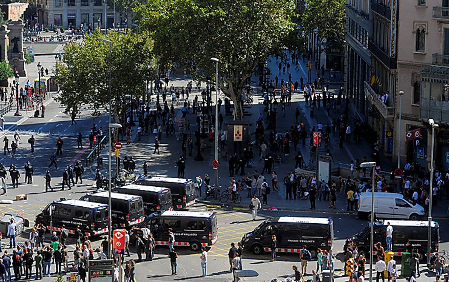 Riot police take to the streets during riots in Barcelona, Wednesday, Sept. 29, 2010. Spanish workers staged a general strike Wednesday to protest austerity measures imposed by a government struggling to slash its budget deficit and overcome recession. (AP Photo/Manu Fernandez)