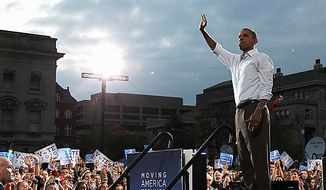 President Barack Obama waves to the crowd at a rally at the University of Wisconsin in Madison, Wis., Tuesday, Sept. 28, 2010. (AP Photo/Charles Dharapak)