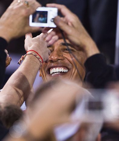President Barack Obama shakes hands after speaking at a rally Tuesday, Sept. 28, 2010, on the University of Wisconsin campus in Madison, Wis. (AP Photo/Morry Gash)